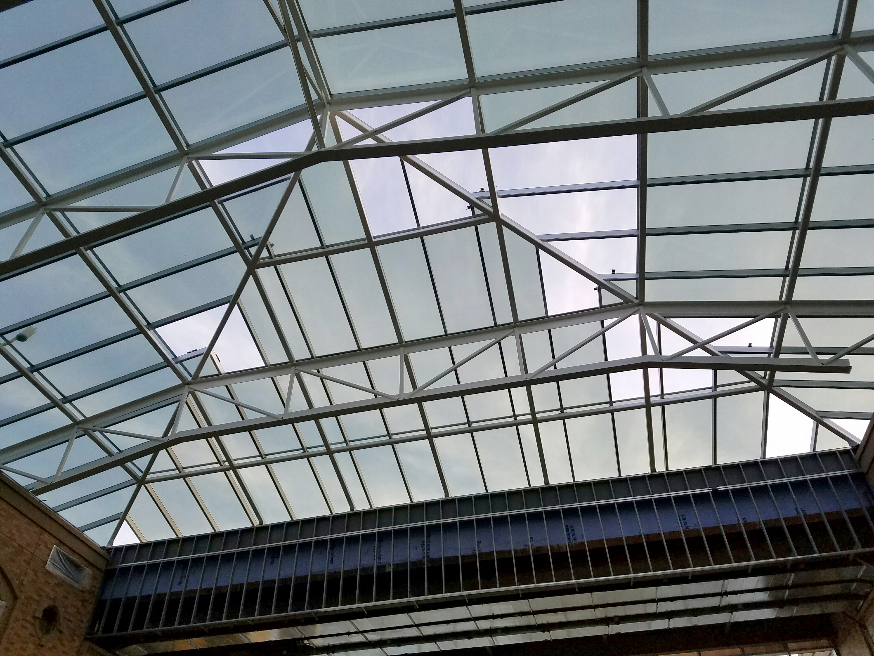 Skylight covers the large courtyard at sanford imaginetics for Large skylights