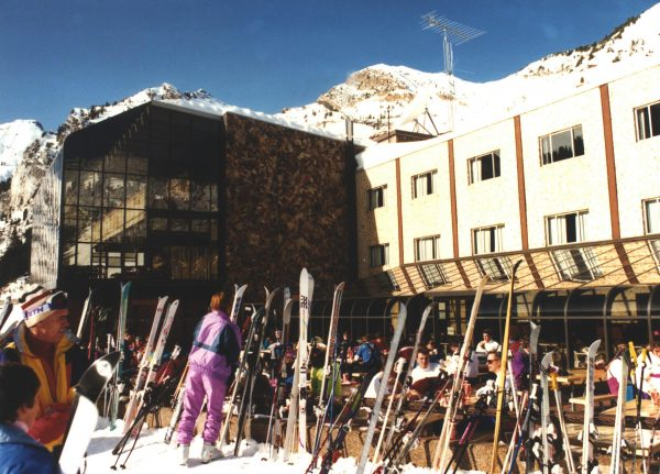Skiers prep area in front of glazed structures